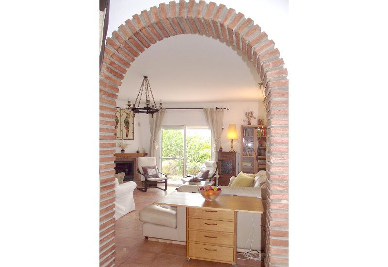 Lounge with view on chimney and terrace door to the garden